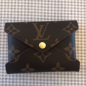 Louis Vuitton small Kirogami snap pouch.